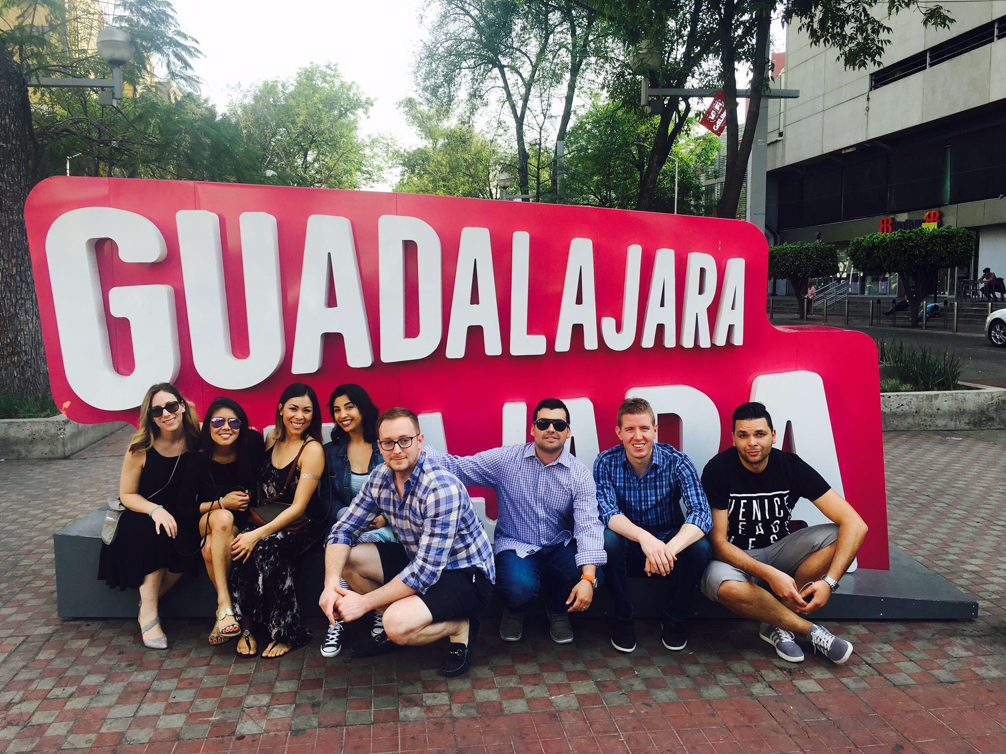 Cydcor's volunteer medical mission team in front of a sign in Guadalajara.