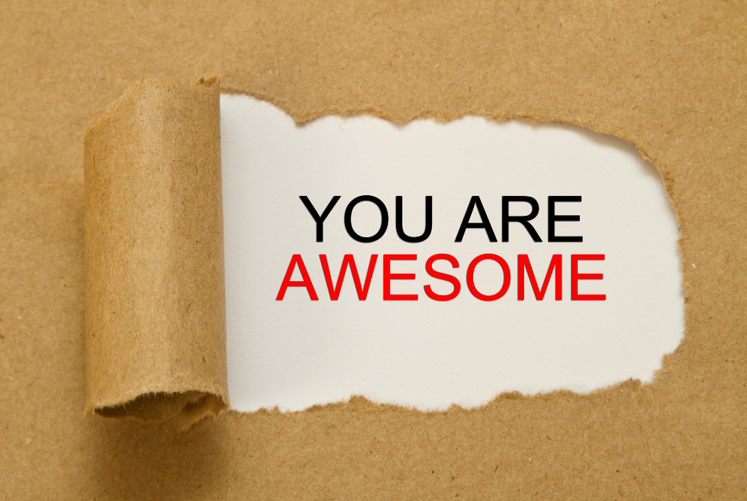 You are awesome words revealed under peeled away paper