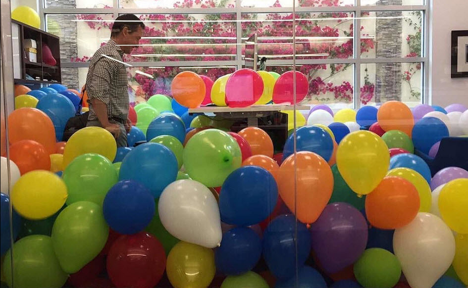 Man Discovers Balloons in His Office