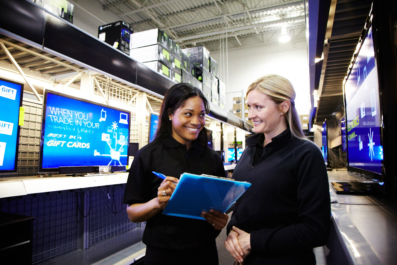 Two sales reps working in a retail store