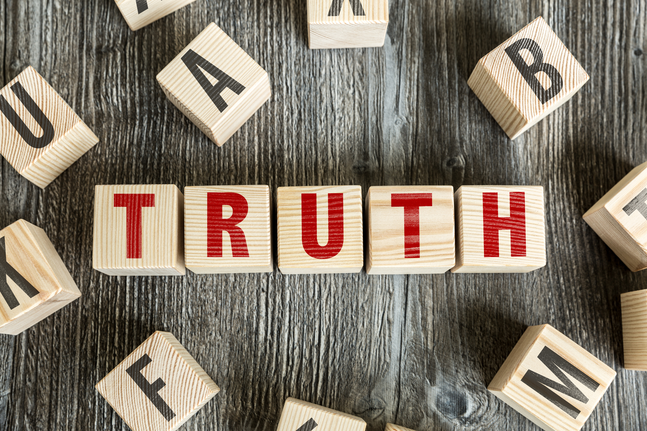 Wooden blocks spelling out the word truth - why truth is an effective sales strategy