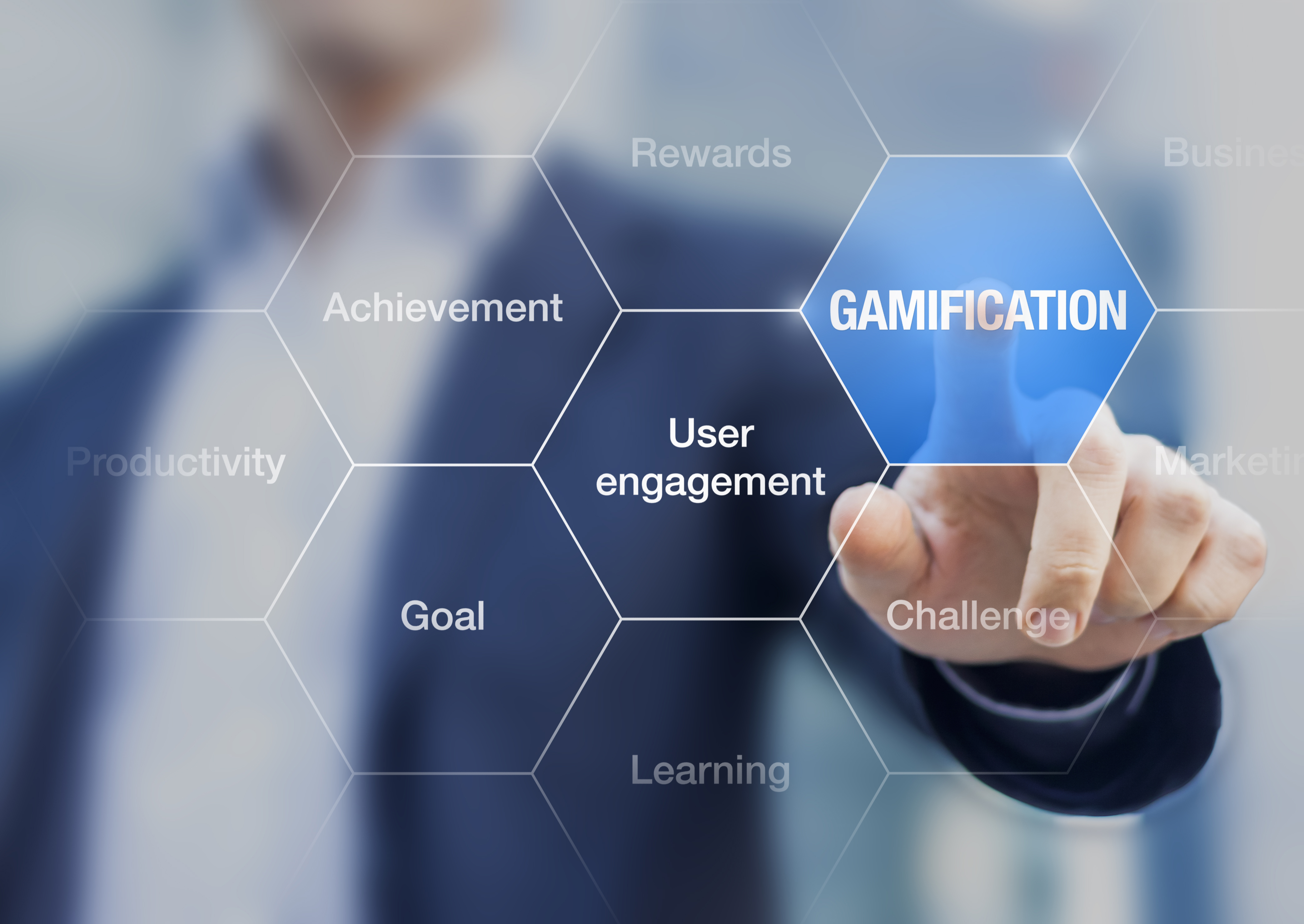 Image of a business man pointing at the word Gamification, user engagement, learning, etc.
