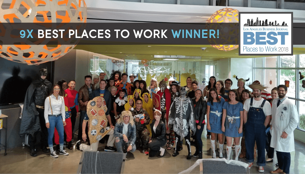 Image of Cydcor team members gathered in the heart for a halloween celebration.