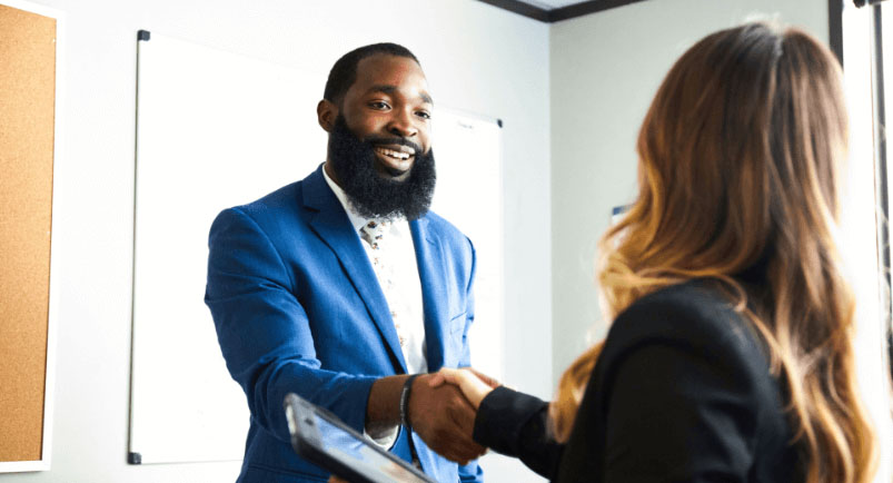 Image of a B2B sales rep shaking hands with a customer