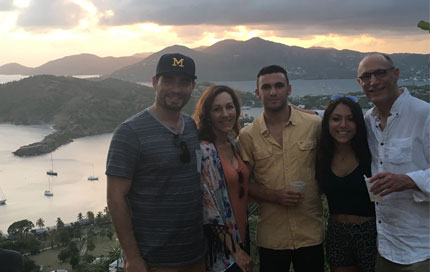 Max Simon poses with his family in front of a beautiful sunset.