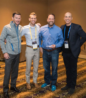 Steve Yaeger poses with AT&T campaign colleagues after accepting a Dealer of the Year award.