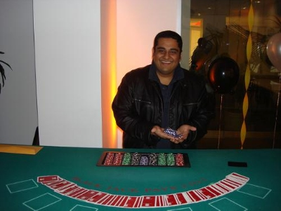 "Atul Varma, Cydcor Retail Recruiter, proudly deals poker at Cydcor's charity ""Casino Night,"" which helped the company raise money toward its $150,000 goal for Operation Smile."